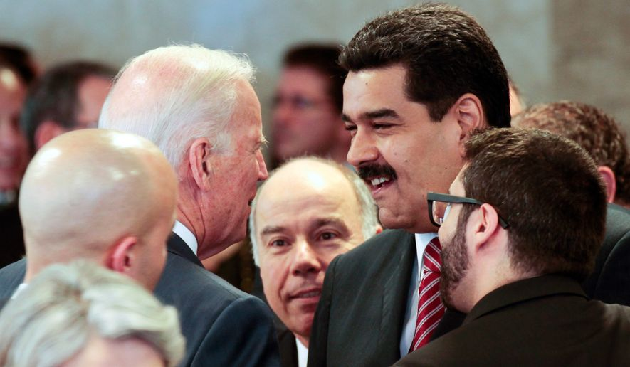 In this photo provided by Miraflores presidential press office, Venezuela's President Nicolas Maduro, right, speaks with U.S. Vice President Joe Biden on the sidelines of the swearing-in ceremony of Brazil's reelected President Dilma Rousseff in Brasilia, Brazil, Jan. 1, 2015. The meeting came two weeks after President Barack Obama signed legislation to impose sanctions on Venezuelan officials accused of violating human rights. Last week, Maduro accused the U.S. of waging a war to destroy the South American country's socialist revolution. (AP Photo/Miguel Angulo, Miraflores Presidential Office)