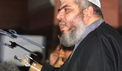 In this July 12, 2002, file photo, radical cleric Mustafa Kamel Mustafa, then known as Sheik Abu Hamza al-Masri, addresses a fundamentalist Islamic conference in London condemning what he said was oppression of Muslims in the West. (AP Photo/Alistair Fuller, File)