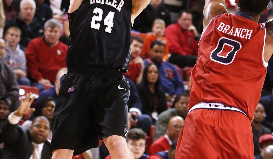 Butler's Kellen Dunham (24) shoots against St. John's Jamal Branch (0) during the first half of an NCAA college basketball game Saturday, Jan. 3, 2015, in New York. (AP Photo/Jason DeCrow)