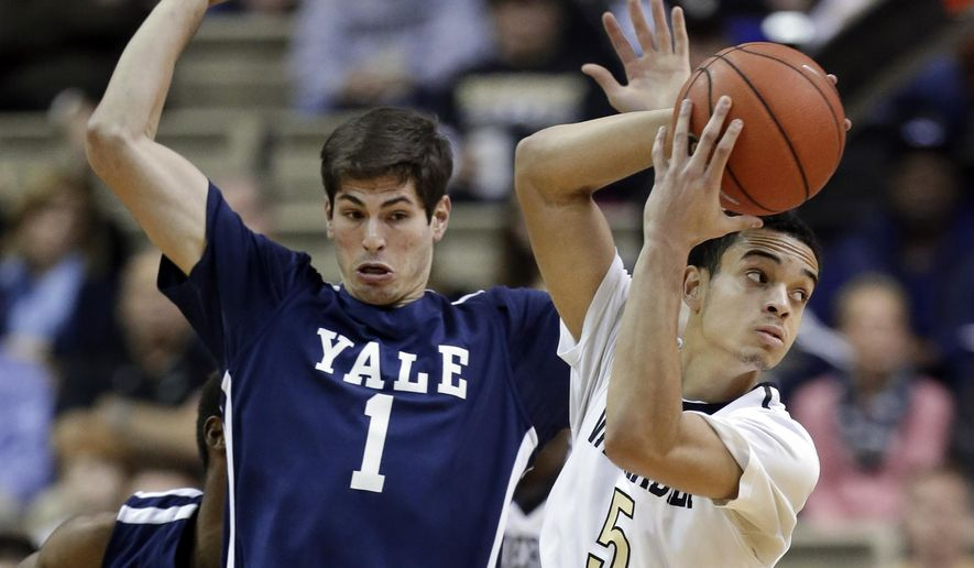 Yale guard Anthony Dallier (1) tries not to foul Vanderbilt guard/forward Matthew Fisher-Davis (5) in the first half of an NCAA college basketball game Saturday, Jan. 3, 2015, in Nashville, Tenn. (AP Photo/Mark Humphrey)