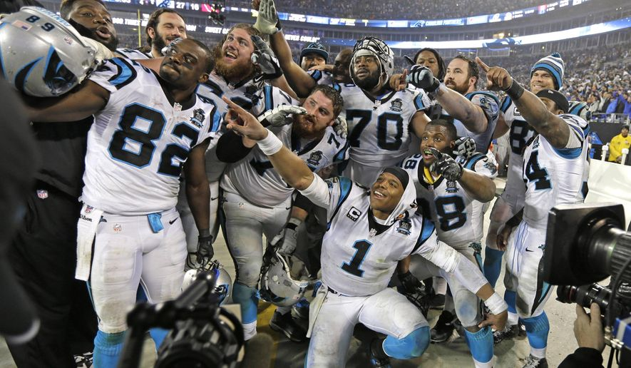 Carolina Panthers players including Cam Newton (1) celebrate in the final moments in the second half of an NFL wild card playoff football game against the Arizona Cardinals in Charlotte, N.C., Saturday, Jan. 3, 2015. (AP Photo/Chuck Burton)