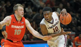Virginia Tech's Justin Bibbs (10), shown against Syracuse last week, scored a season-high 25 points but the Hokies lost 86-75 to Florida State on Tuesday. (AP Photo/Don Petersen)