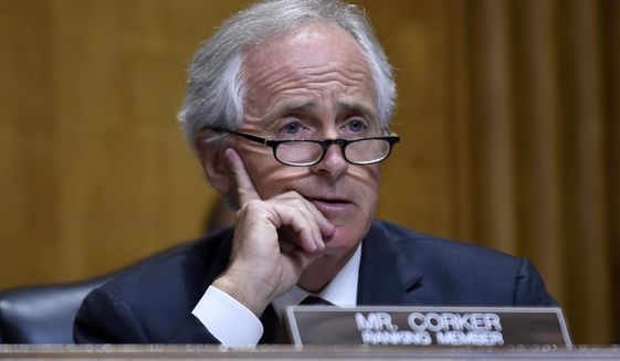 FILE - In this July 29, 2014 file photo, Sen. Bob Corker, R-Tenn. listens on Capitol Hill in Washington. Republican senators poised to lead major committees when the GOP takes charge are intent on pushing back many of President Barack Obama's policies, setting up potential showdowns over environmental rules, financial regulations and national security. (AP Photo/Susan Walsh, File)