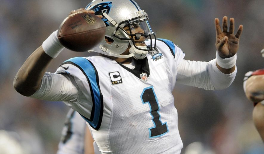 Carolina Panthers' Cam Newton (1) looks to pass against the Arizona Cardinals in the first half of an NFL wild card playoff football game in Charlotte, N.C., Saturday, Jan. 3, 2015. (AP Photo/Mike McCarn)