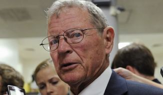 FILE - in this July 8, 2014, file photo, Sen. James Inhofe, R-Okla. speaks to reporters on Capitol Hill in Washington. Republican senators poised to lead major committees when the GOP takes charge are intent on pushing back many of President Barack Obama's policies, setting up potential showdowns over environmental rules, financial regulations and national security. (AP Photo/Susan Walsh, File)