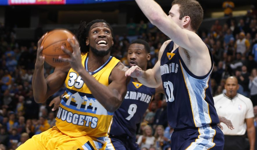 Denver Nuggets forward Kenneth Faried, left, goes up for a shot as Memphis Grizzlies forward Tony Allen, center, and forward Jon Leuer cover in the first quarter of an NBA basketball game Saturday, Jan. 3, 2015, in Denver. (AP Photo/David Zalubowski)