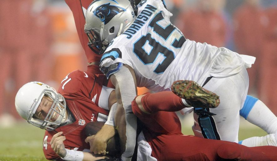 Arizona Cardinals' Ryan Lindley (14) is sacked by Carolina Panthers' Charles Johnson (95) in the second half of an NFL wild card playoff football game in Charlotte, N.C., Saturday, Jan. 3, 2015. The Panthers won 27-16. (AP Photo/Mike McCarn)