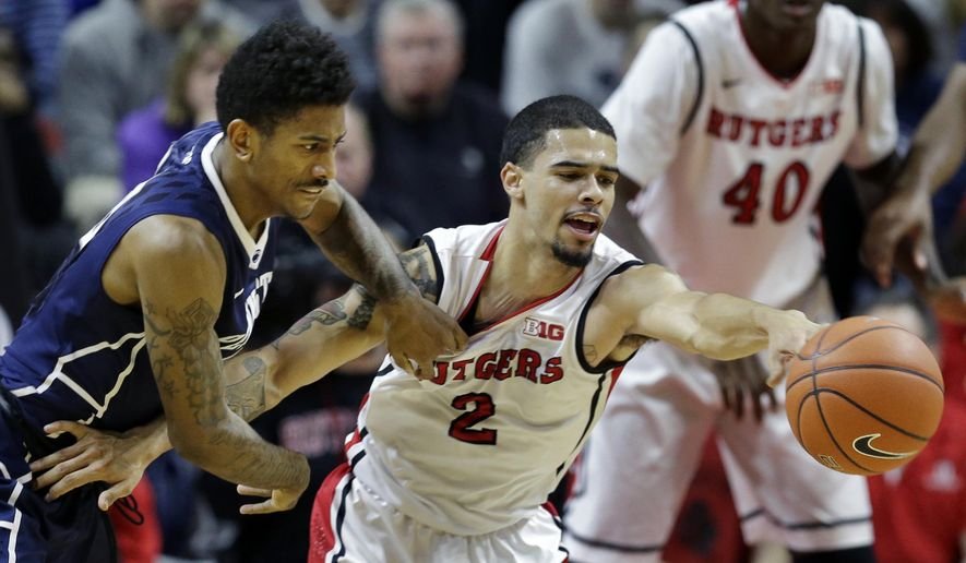 Rutgers' Bishop Daniels (2) tries to control the ball as Penn State's Geno Thorpe, left, defends during the first half of an NCAA college basketball game Saturday, Jan. 3, 2015, in Piscataway, N.J. (AP Photo/Mel Evans)