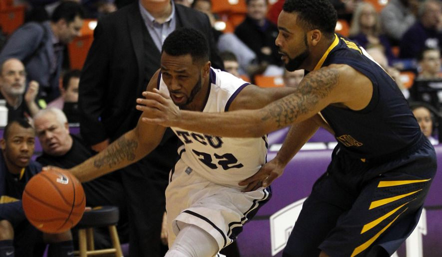 TCU guard Trey Zeigler (32) drives past West Virginia guard Jaysean Paige (0) during the first half of an NCAA college basketball game, Saturday, Jan. 3, 2015, in Fort Worth, Texas. (AP Photo/Mike Stone)