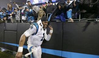 Carolina Panthers' Cam Newton (1) celebrates with fans after an NFL wild card playoff football game against the Arizona Cardinals  in Charlotte, N.C., Saturday, Jan. 3, 2015. The Panthers won 27-16. (AP Photo/Bob Leverone)