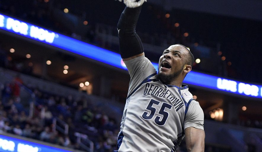 Georgetown guard Jabril Trawick (55) dunks against Creighton during the second half of an NCAA college basketball game, Saturday, Jan. 3, 2015, in Washington. Georgetown won 76-61. (AP Photo/Nick Wass)