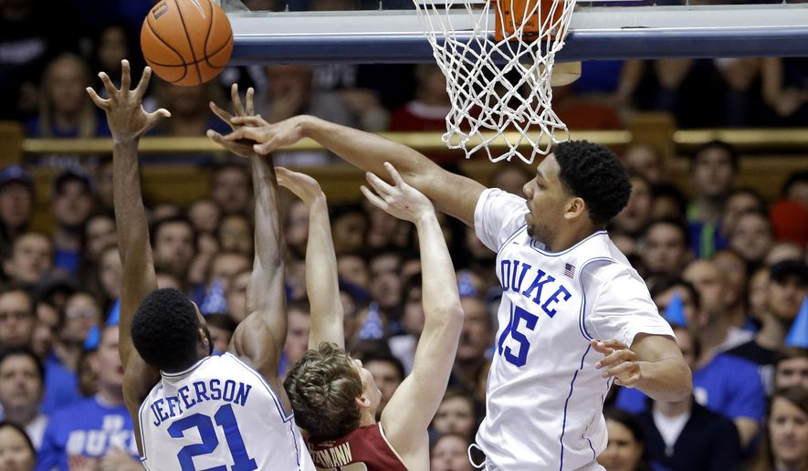 Duke's Jahlil Okafor (15) and Amile Jefferson (21) block Boston College's Patrick Heckmann (33) during the first half of an NCAA college basketball game in Durham, N.C., Saturday, Jan. 3, 2015. (AP Photo/Gerry Broome)
