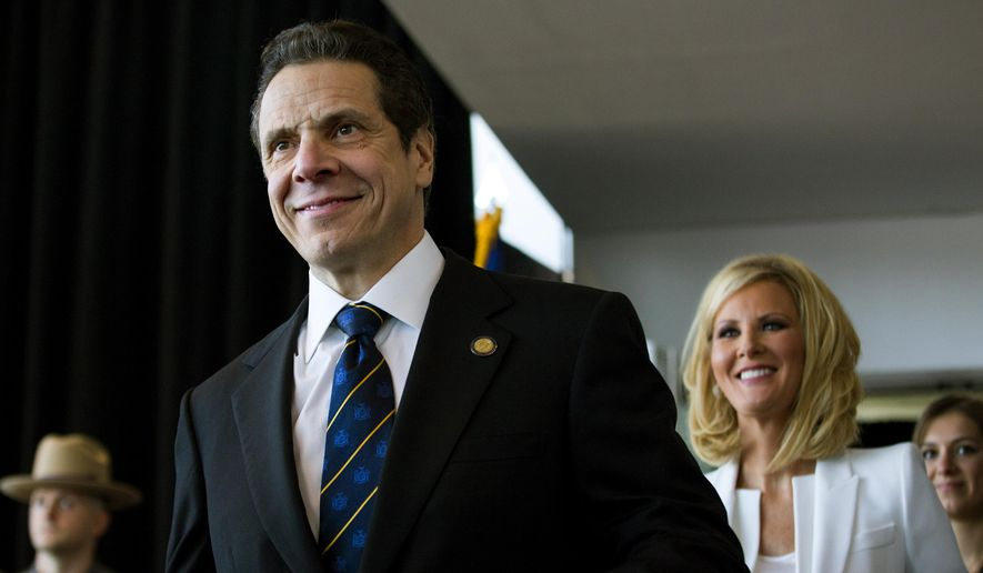 New York Gov. Andrew Cuomo arrives for his inaugural ceremony at One World Trade Center in New York, Thursday, Jan. 1, 2015. At right is Sandra Lee, girlfriend of Gov. Cuomo. Cuomo kicked off his second term as governor Thursday with a pep talk, urging New Yorkers to lead by example through some of the nation's worst problems.  (AP Photo/Craig Ruttle, Pool)