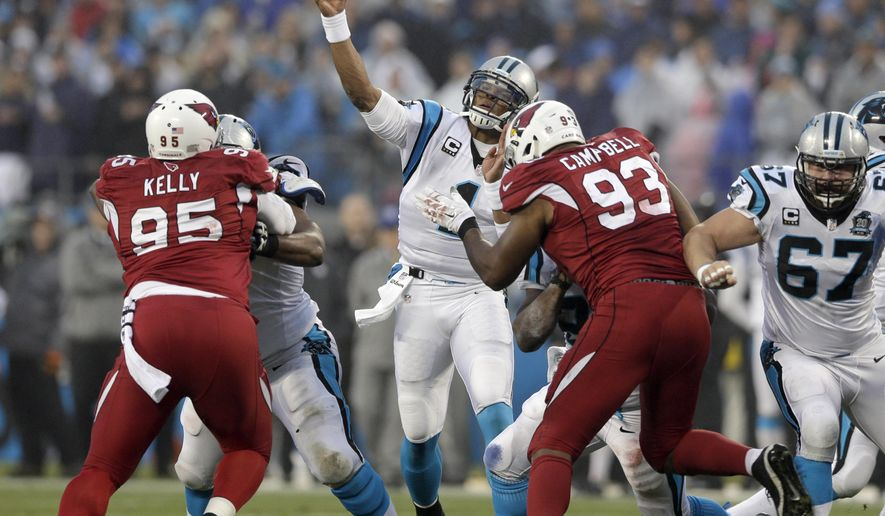 Carolina Panthers' Cam Newton (1) throws a pass against the Arizona Cardinals in the first half of an NFL wild card playoff football game in Charlotte, N.C., Saturday, Jan. 3, 2015. (AP Photo/Chuck Burton)