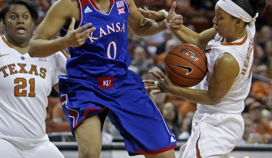 Texas guard Krystel Henderson, right, steals the ball from Kansas guard Asia Boyd, left, during the first half an NCAA college basketball game, Saturday, Jan. 3, 2015, in Austin, Texas. (AP Photo/Michael Thomas)