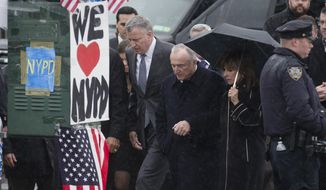 New York City Mayor Bill de Blasio, center left, New York Police Department Commissioner Bill Bratton, center right, and Rikki Klieman, Bratton's wife, second from right, arrive at the wake of New York Police Department Officer Wenjian Liu at Aievoli Funeral Home, Saturday, Jan. 3, 2015, in the Brooklyn borough of New York. Liu and his partner, Officer Rafael Ramos, were killed Dec. 20, as they sat in their patrol car on a Brooklyn street. The shooter, Ismaaiyl Brinsley, later killed himself. (AP Photo/John Minchillo)