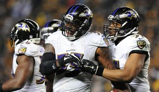 Baltimore Ravens outside linebacker Terrell Suggs (55) celebrates after intercepting a pass by Pittsburgh Steelers quarterback Ben Roethlisberger (7) in the fourth quarter of an NFL wildcard playoff football game, Saturday, Jan. 3, 2015, in Pittsburgh. (AP Photo/Don Wright)