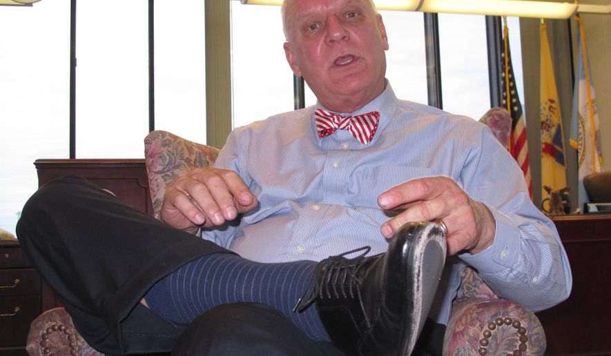 "In this Dec. 29, 2014 photo, Atlantic City, N.J. Mayor Don Guardian discusses the future of his seaside gambling resort, in his office. Following a year in which four of his city's 12 casinos shut down, Guardian predicts 2015 will be ""a year of healing"" even though he expects one more casino to close during the year. (AP Photo/Wayne Parry)"
