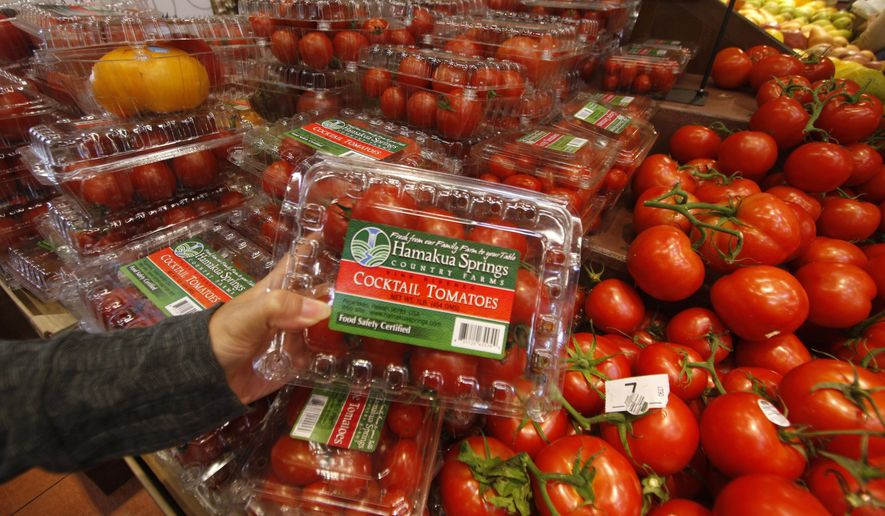 FILE - In this Dec. 2, 2008, file photo, a container of Hamakua Springs cocktail tomatoes are held up for a photo at a Whole Foods store in Honolulu. Hawaii's supply of locally grown tomatoes has gotten considerably smaller after one of the state's biggest producers decided to exit the business. Hamakua Springs Country Farms on Hawaii Island ceased tomato production at the end of November, leaving stores around the state such as Costco, Foodland, Safeway and Whole Foods without the company's hydroponically grown varieties, which included cocktail, beef and heirloom tomatoes. (AP Photo/Honolulu Star-Bulletin, Dennis Oda, File)
