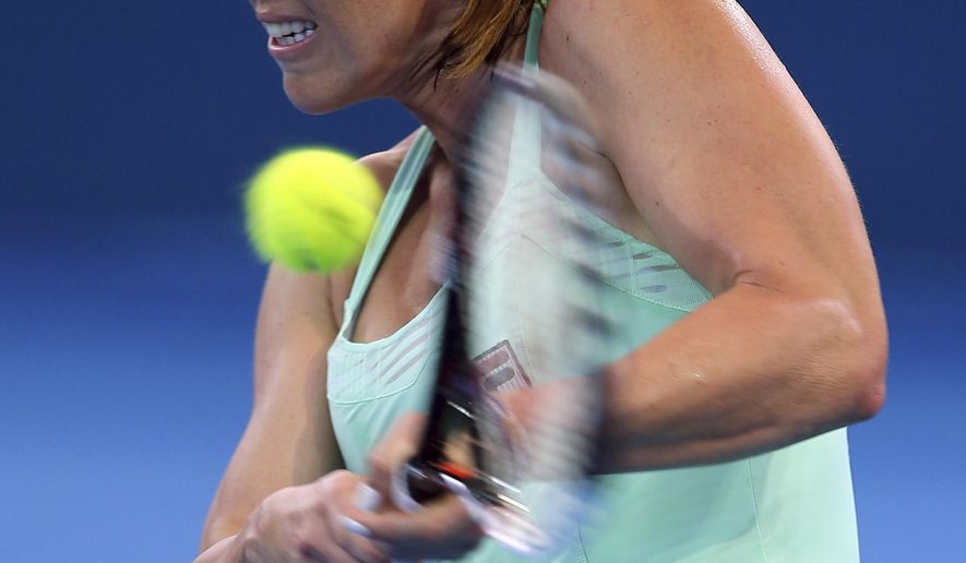 Jelena Jankovic of Serbia plays a shot during her first round match against Ajla Tomljanovic of Croatia at the Brisbane International tennis tournament n Brisbane, Australia, Sunday, Jan. 4, 2015. (AP Photo/Tertius Pickard)