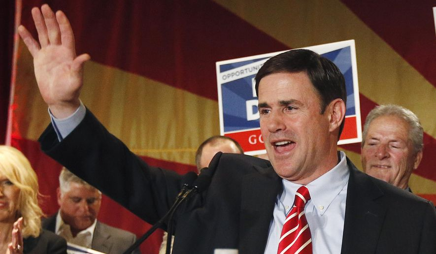 FILE - In this Nov. 4, 2014, file photo, Doug Ducey, who was elected as Arizona governor, waves to supporters on election night in Phoenix. Ducey will be inaugurated on Monday, Jan. 5, 2015, (AP Photo/Ross D. Franklin, File)