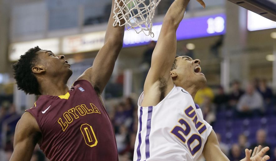 Northern Iowa guard Jeremy Morgan, right, shoots over Loyola guard Donte Ingram, left, during the first half of an NCAA college basketball game, Sunday, Jan. 4, 2015, in Cedar Falls, Iowa. (AP Photo/Charlie Neibergall)