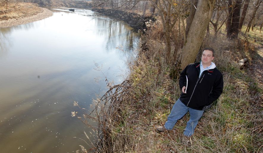 In this Dec. 30, 2014, photo, Environmental attorney Chris Habel stands for a photo along the bank of the East Fork of the Little Miami River in the Valley View Nature Preserve in Milford, Ohio.  Habel has spent thousands of pro-bono hours working with a number of entities and applying for grants and funding to make the 190-acre area a preserve. (AP Photo/The Cincinnati Enquirer, Patrick Reddy)  MANDATORY CREDIT;  NO SALES