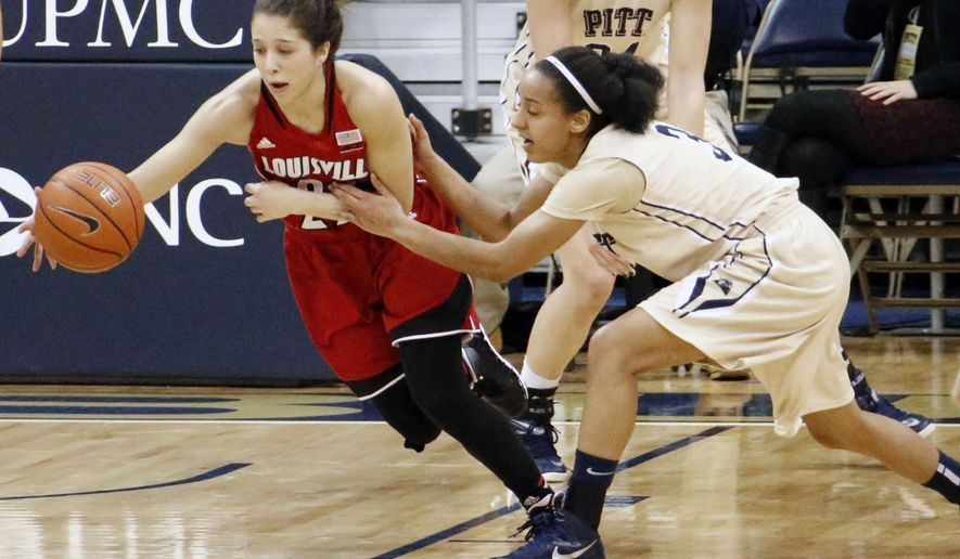Louisville's Jude Schimmel (22) is fouled by Pittsburgh's Brianna Kiesel (3) during the second half of an NCAA women's college basketball game in Pittsburgh Sunday, Jan. 4, 2015.(AP Photo/Tom E. Puskar)