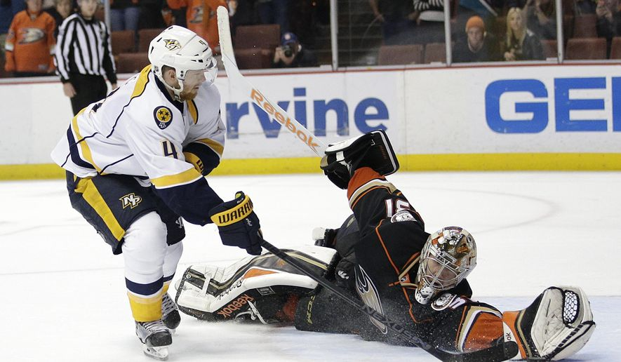 Anaheim Ducks goalie Frederik Andersen, right, of Denmark, stops a shot by Nashville Predators' Ryan Ellis during a shootout of an NHL hockey game Sunday, Jan. 4, 2015, in Anaheim, Calif. The Ducks won 4-3. (AP Photo/Jae C. Hong)