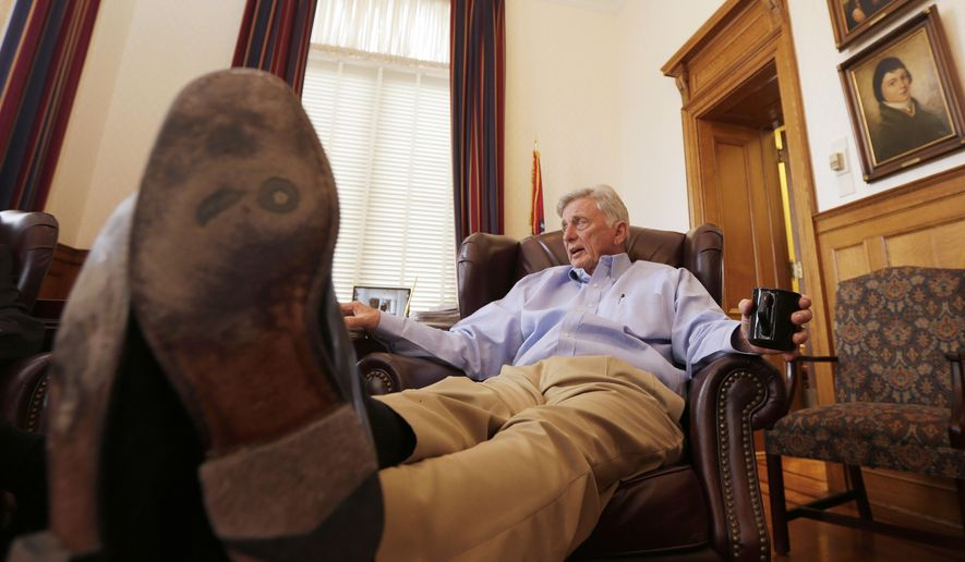 In this photo taken Dec. 29, 2014, Arkansas Gov. Mike Beebe relaxes as he is interviewed in the governor's office at the Arkansas state Capitol in Little Rock, Ark. Beebe leaves office due to term limits, handing the reins of the state over to Republican Gov.-elect Asa Hutchinson. Despite his high popularity, Beebe insists this means this end of his time in elected politics.  (AP Photo/Danny Johnston)