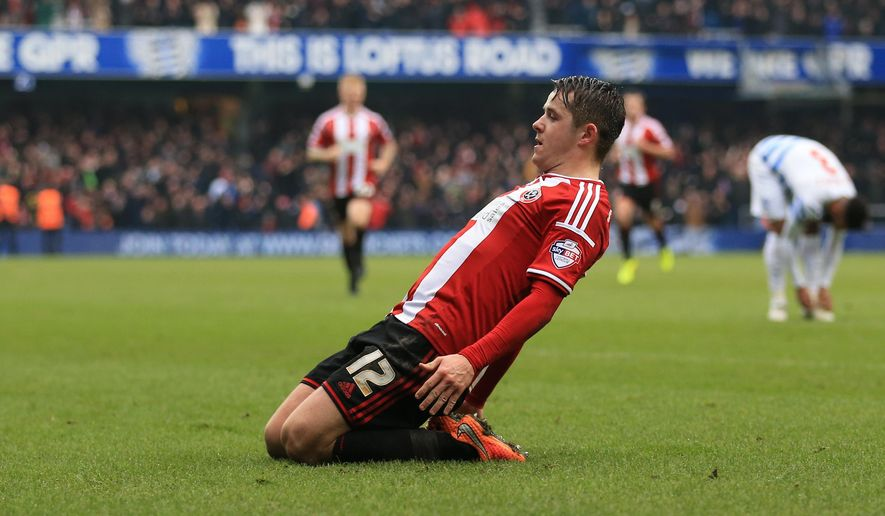Sheffield United Marc McNulty celebrates scoring his sides first goal of the game against Queens Park Rangers during their FA Cup third round soccer match at Loftus Road, London, Sunday, Jan. 4, 2015. (AP Photo/Nigel French, PA Wire)     UNITED KINGDOM OUT    -   NO SALES    -    NO ARCHIVES