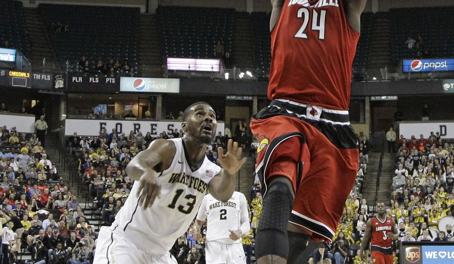 Louisville's Montrezl Harrell (24) goes up to dunk past Wake Forest's Darius Leonard (13) during the first half of an NCAA college basketball game in Charlotte, N.C., Sunday, Jan. 4, 2015. (AP Photo/Chuck Burton)