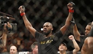 Jon Jones celebrates after defeating Daniel Cormier during their light heavyweight title mixed martial arts bout at UFC 182, Saturday, Jan. 3, 2015, in Las Vegas. (AP Photo/John Locher)
