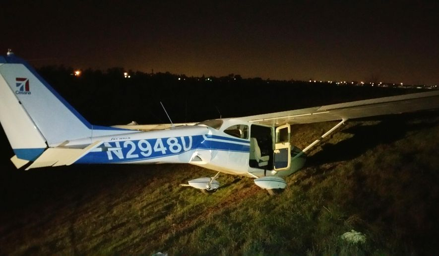 This photo provided by the Fresno County Sheriff's Department shows a Cessna 172 that crashed as it was preparing to land at an airport in Fresno, Calif. Saturday evening, Jan. 3, 2015. All three people aboard, a woman and two men, escaped serious injury, authorities said. Tony Botti of the Fresno County Sheriff's office says the pilot tried to land on a roadway but ended up clipping some power lines and going down. (AP Photo/Fresno County Sheriff's Department, Tony Botti)