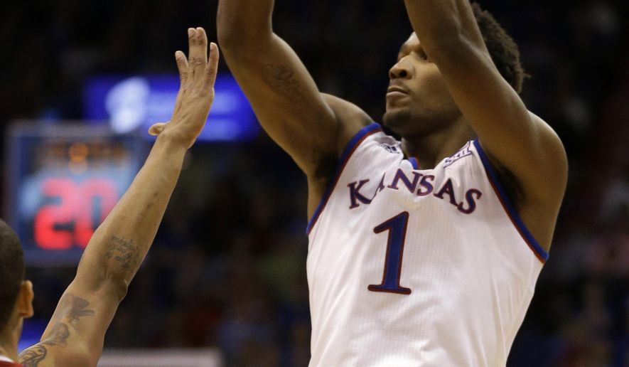 Kansas guard Wayne Selden Jr. (1) shoots a three-point basket during the first half of an NCAA college basketball game against UNLV in Lawrence, Kan., Sunday, Jan. 4, 2015.  (AP Photo/Orlin Wagner)