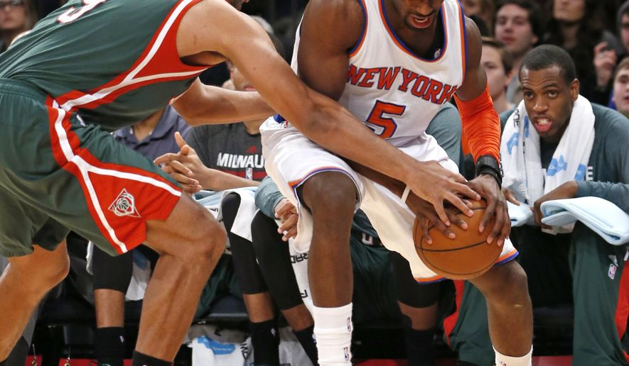 Milwaukee Bucks guard Jared Dudley (9) tries to strip the ball from New York Knicks guard Tim Hardaway Jr. (5) in the second half of an NBA basketball game at Madison Square Garden in New York, Sunday, Jan. 4, 2015. The Bucks defeated the Knicks 95-82. (AP Photo/Kathy Willens)