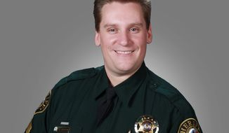 This Nov. 2, 2009 photo provided by the Jefferson County, Colo., Sheriff's Office shows Sgt. Sean Renfro. Renfro was off duty when he was killed Saturday afternoon, Jan. 3, 2015, after he was struck by a passing car at the scene of a multi-car crash on U.S. 285 north of Conifer, Colo. Authorities say Renfro was directing traffic following the crash when another car lost control and crossed the highway, striking Renfro and another car. Cpl. Heather Cobler, spokeswoman for the Colorado State Patrol, says it was snowing at the time of the accident and the road was covered with snow. (AP Photo/Jefferson County Sheriff's Office)