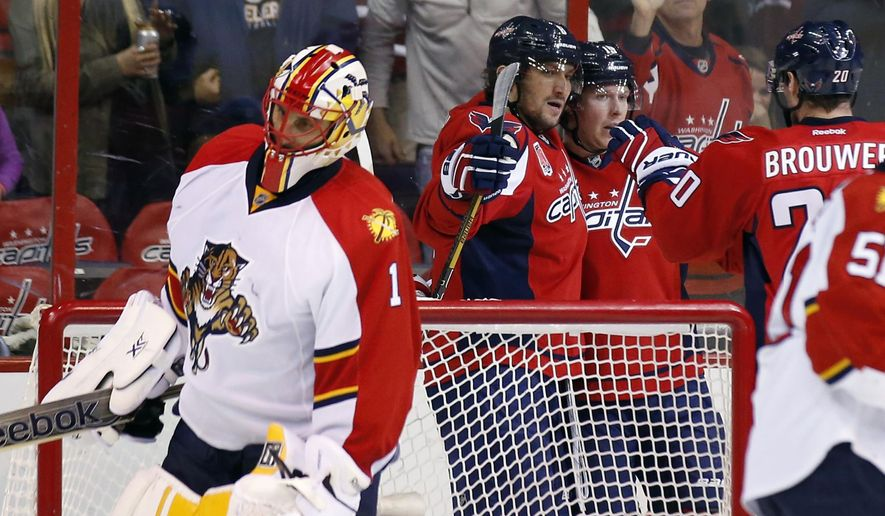 Florida Panthers goalie Roberto Luongo (1) stands as Washington Capitals left wing Alex Ovechkin (8), from Russia, center Nicklas Backstrom (19), from Sweden, and right wing Troy Brouwer (20) celebrate Ovechkin's goal in the second period of an NHL hockey game, Sunday, Jan. 4, 2015, in Washington. (AP Photo/Alex Brandon)