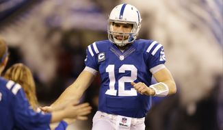 Indianapolis Colts' Andrew Luck (12) is introduced before a NFL wildcard playoff football game between the Indianapolis Colts and the Cincinnati Bengals Sunday, Jan. 4, 2015, in Indianapolis. (AP Photo/Michael Conroy)