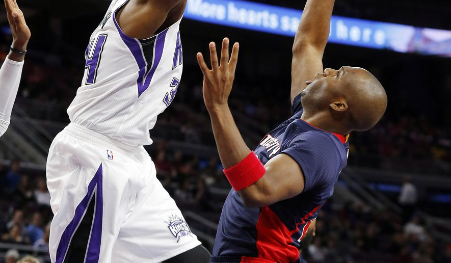 Sacramento Kings forward Jason Thompson (34) blocks a shot by Detroit Pistons guard Jodie Meeks (20) in the first half of an NBA basketball game in Auburn Hills, Mich., Sunday, Jan. 4, 2015. (AP Photo/Paul Sancya)