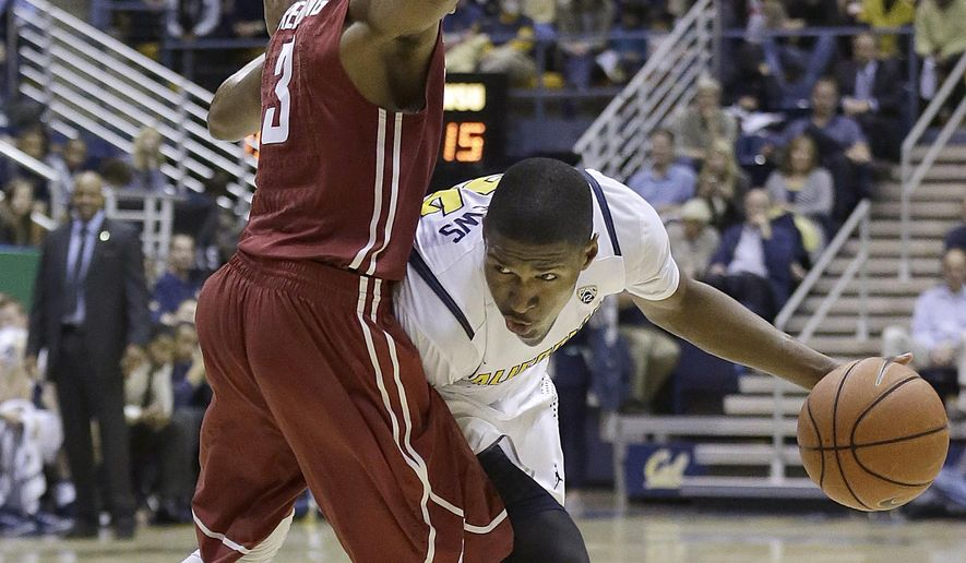 California guard Jordan Mathews, right, is guarded by Washington State guard Ny Redding (3) during the first half of an NCAA college basketball game in Berkeley, Calif., Sunday, Jan. 4, 2015. (AP Photo/Jeff Chiu)