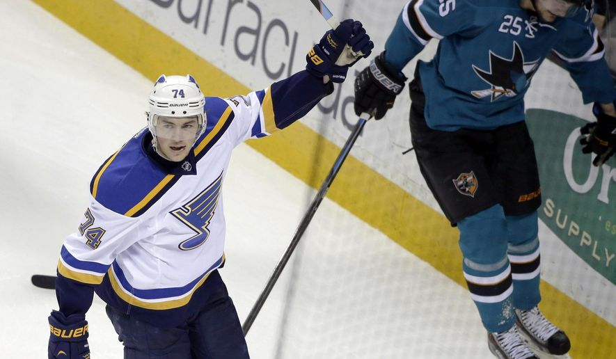 St. Louis Blues' T.J. Oshie (74) celebrates his goal next to San Jose Sharks' Tye McGinn (25) during the second period of an NHL hockey game Saturday, Jan. 3, 2015, in San Jose, Calif. (AP Photo/Marcio Jose Sanchez)
