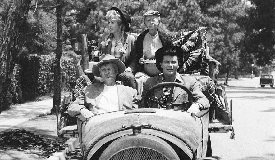 "This 1967 file photo shows, cast members, front, from left, Buddy Ebsen and Max Baer, and rear, from left, Donna Douglas and Irene Ryan, of the television series ""The Beverly Hillbillies."" (AP Photo, File)"