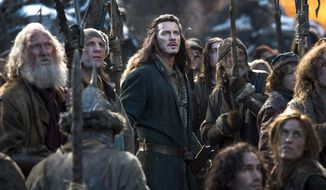 "This photo provided by Warner Bros. Entertainment shows Luke Evans, center, as Bard in the fantasy adventure ""The Hobbit: The Battle of the Five Armies,"" a production of New Line Cinema and Metro-Goldwyn-Mayer Pictures (MGM), releases by Warner Bros. Pictures and MGM. (AP Photo/Warner Bros. Entertainment Inc.- MGM, Mark Pokorny)"