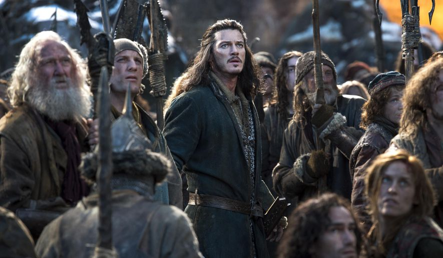 """This photo provided by Warner Bros. Entertainment shows Luke Evans, center, as Bard in the fantasy adventure """"The Hobbit: The Battle of the Five Armies,"""" a production of New Line Cinema and Metro-Goldwyn-Mayer Pictures (MGM), releases by Warner Bros. Pictures and MGM. (AP Photo/Warner Bros. Entertainment Inc.- MGM, Mark Pokorny)"""