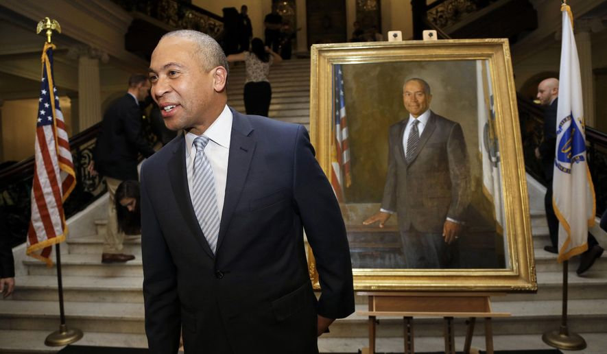Massachusetts Gov. Deval Patrick, left, stands near his official state portrait following ceremonies Sunday, Jan. 4, 2015, at the Statehouse, in Boston. Patrick's portrait will hang in the Statehouse alongside those of other recent governors including Mitt Romney, Paul Cellucci, Bill Weld, Michael Dukakis and former acting Gov. Jane Swift. (AP Photo/Steven Senne)