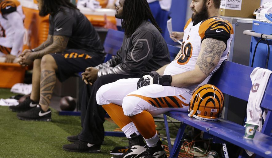 Cincinnati Bengals' Margus Hunt (99) sits on the bench near the end of an NFL wildcard playoff football game against the Indianapolis Colts Sunday, Jan. 4, 2015, in Indianapolis. Indianapolis defeated Cincinnati 26-10. (AP Photo/Michael Conroy)