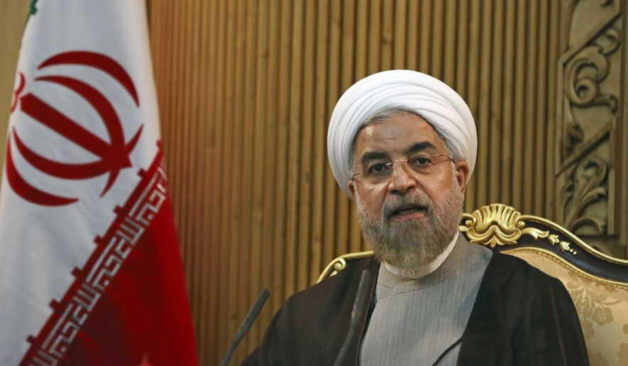 "Iranian President Hassan Rouhani briefs media prior to departing Mehrabad airport to attend the United Nations General Assembly, in Tehran, Iran. Rouhani said Sunday, Jan. 4, 2015, that ongoing nuclear negotiations with world powers are a matter of ""heart,"" not just centrifuges ahead of talks next week in Geneva. (AP Photo/Vahid Salemi, File)"