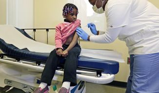 In a Jan. 9, 2013, file photo, 4-year-old Gabriella Diaz sits as registered nurse Charlene Luxcin, right, administers a flu shot at the Whittier Street Health Center in Boston, Mass. The Centers for Disease Control and Prevention on Monday, Jan. 5, 2014, reported flu season is getting worse. (AP Photo/Charles Krupa, File)