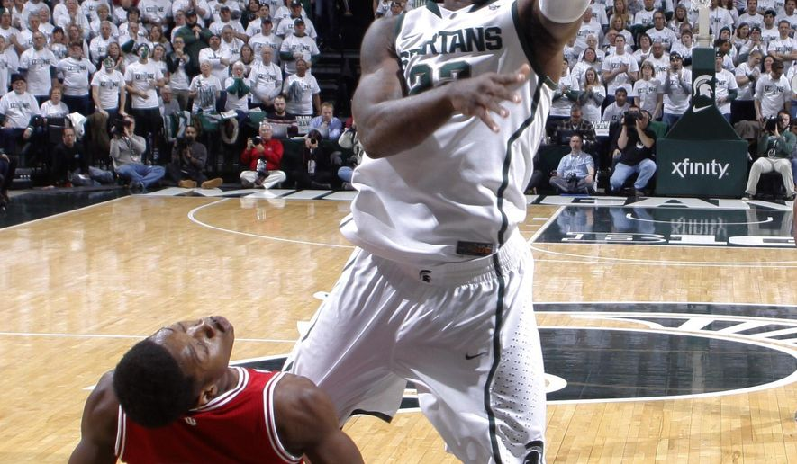 Michigan State's Branden Dawson, top, goes up for a layup over Indiana's Emmitt Holt (25) during the first half of an NCAA college basketball game, Monday, Jan. 5, 2015, in East Lansing, Mich. (AP Photo/Al Goldis)